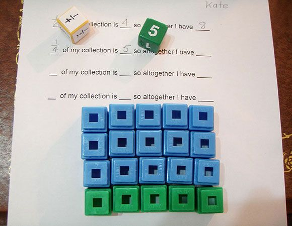 Two dice, one die displaying 1/4 and the other 5. One set of 5 cubes ...