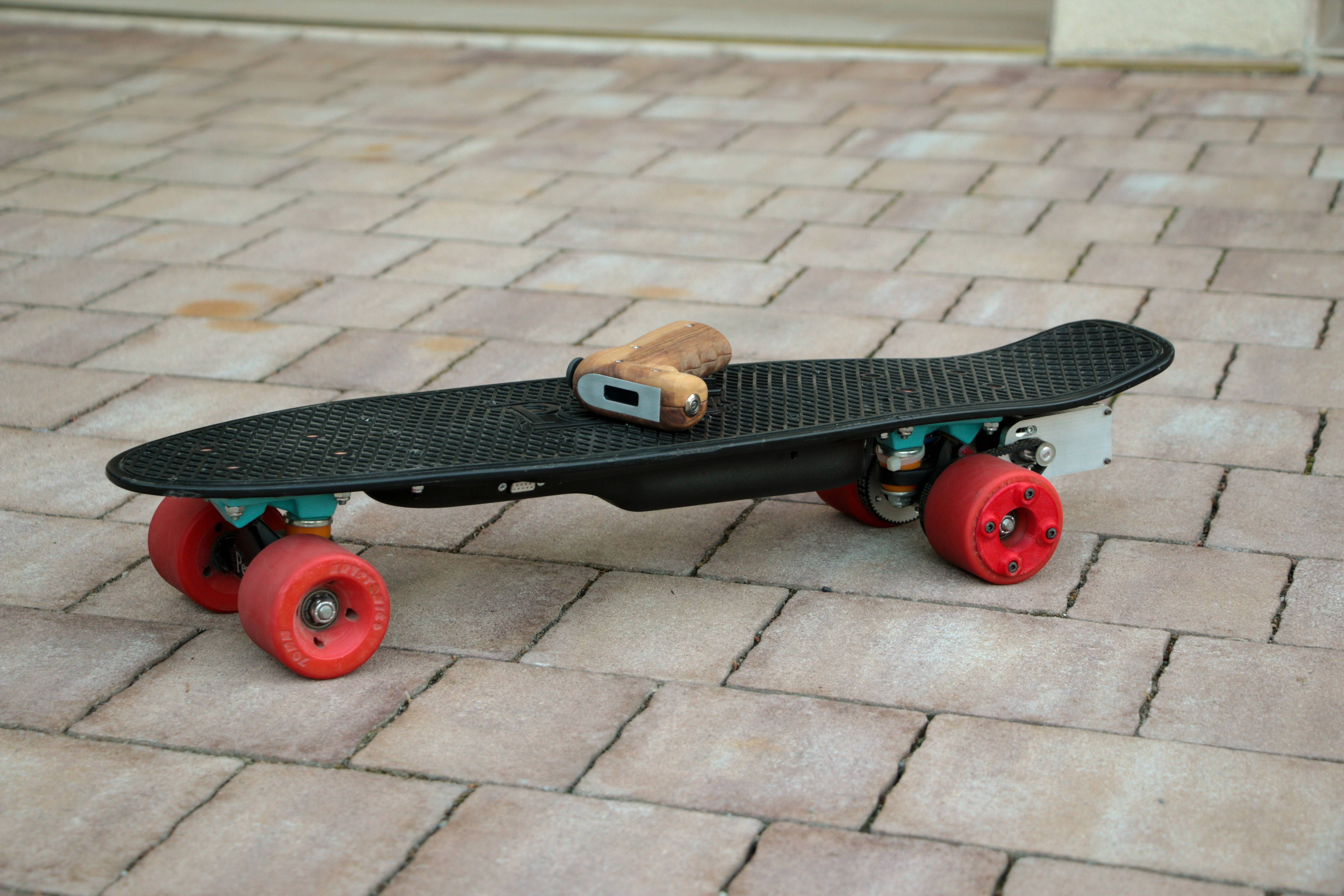 Electric penny skateboard and remote made from wood