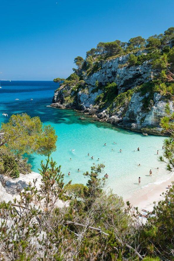 Bathers on Cala Macarelleta, one of Menorca's loveliest beach spots. #mostbeautifulbeaches #beach #travel #beachbeauty #worldtravel #travelideas