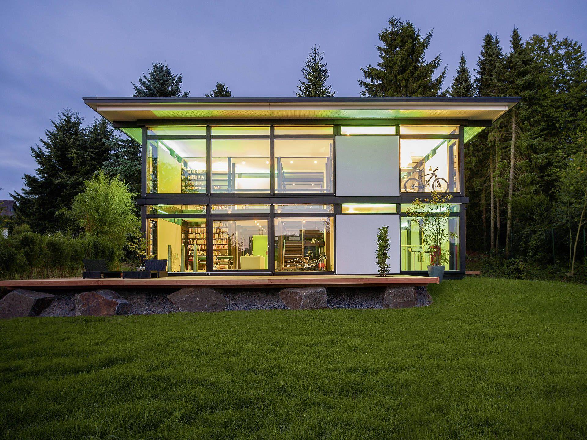 Huf haus modum 7 10 mit flachdach fachwerkhaus von huf for Musterhaus flachdach