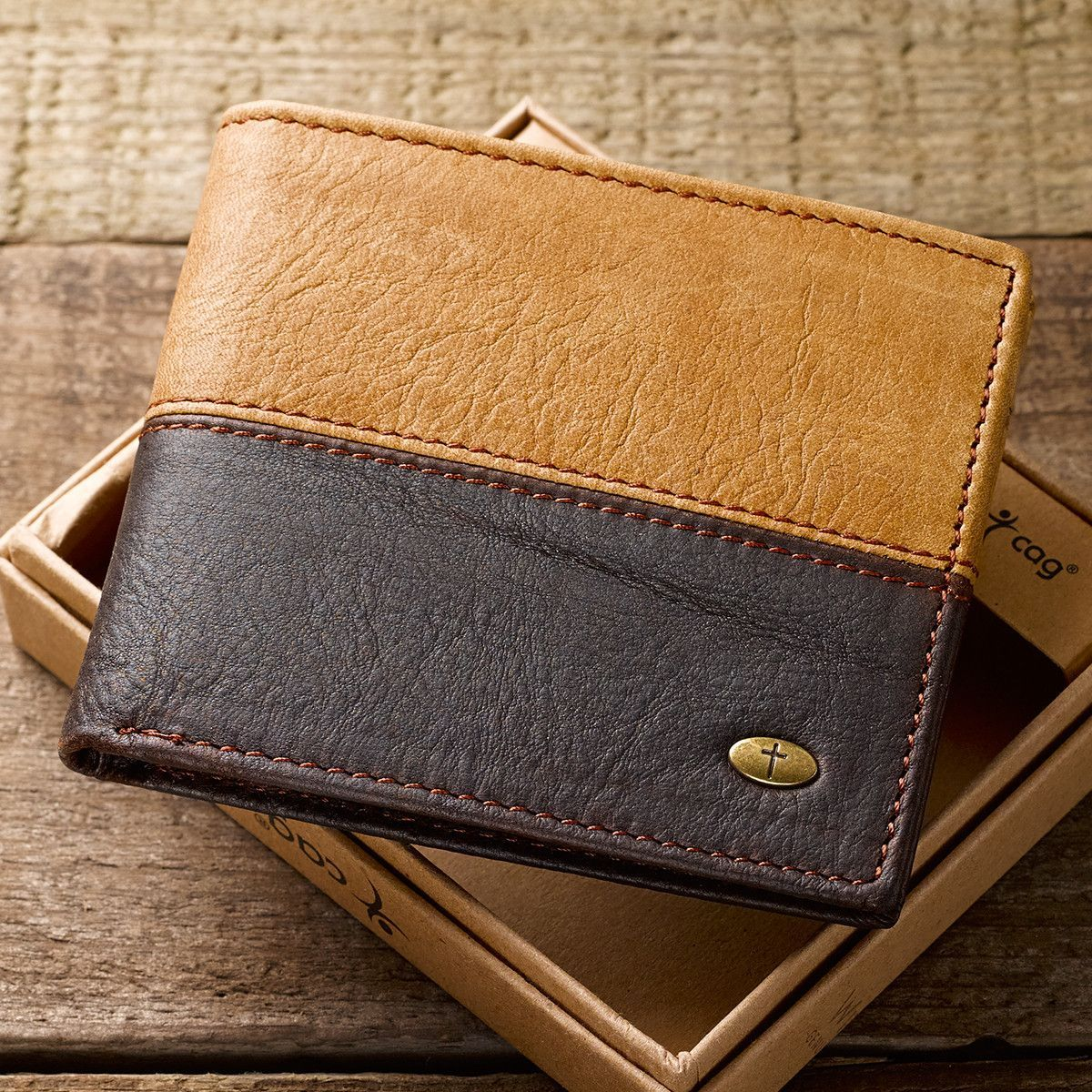 f25135194be6e Our black and brown men s leather wallet, with contrast stitching, sports  an antique brass, cross-engraved stud. Inside are 2 full length bill fold  pockets, ...