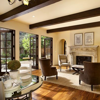 Traditional family room paint color brown trim design for Paint colors that go with brown trim