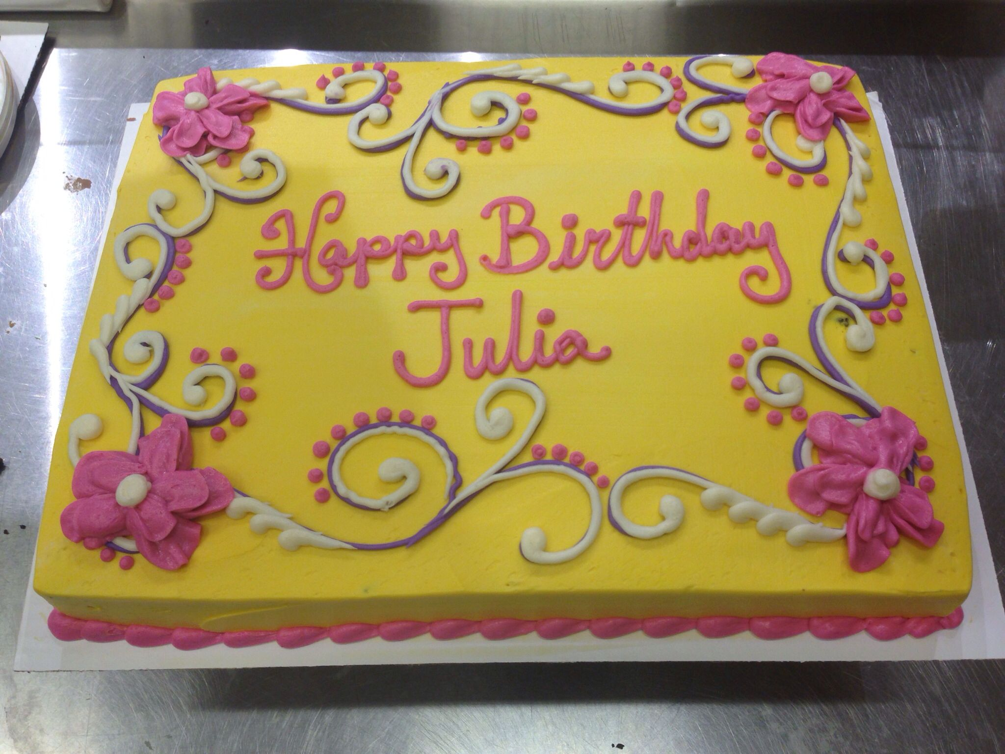 Yellow buttercream cake with white and pink buttercream ...