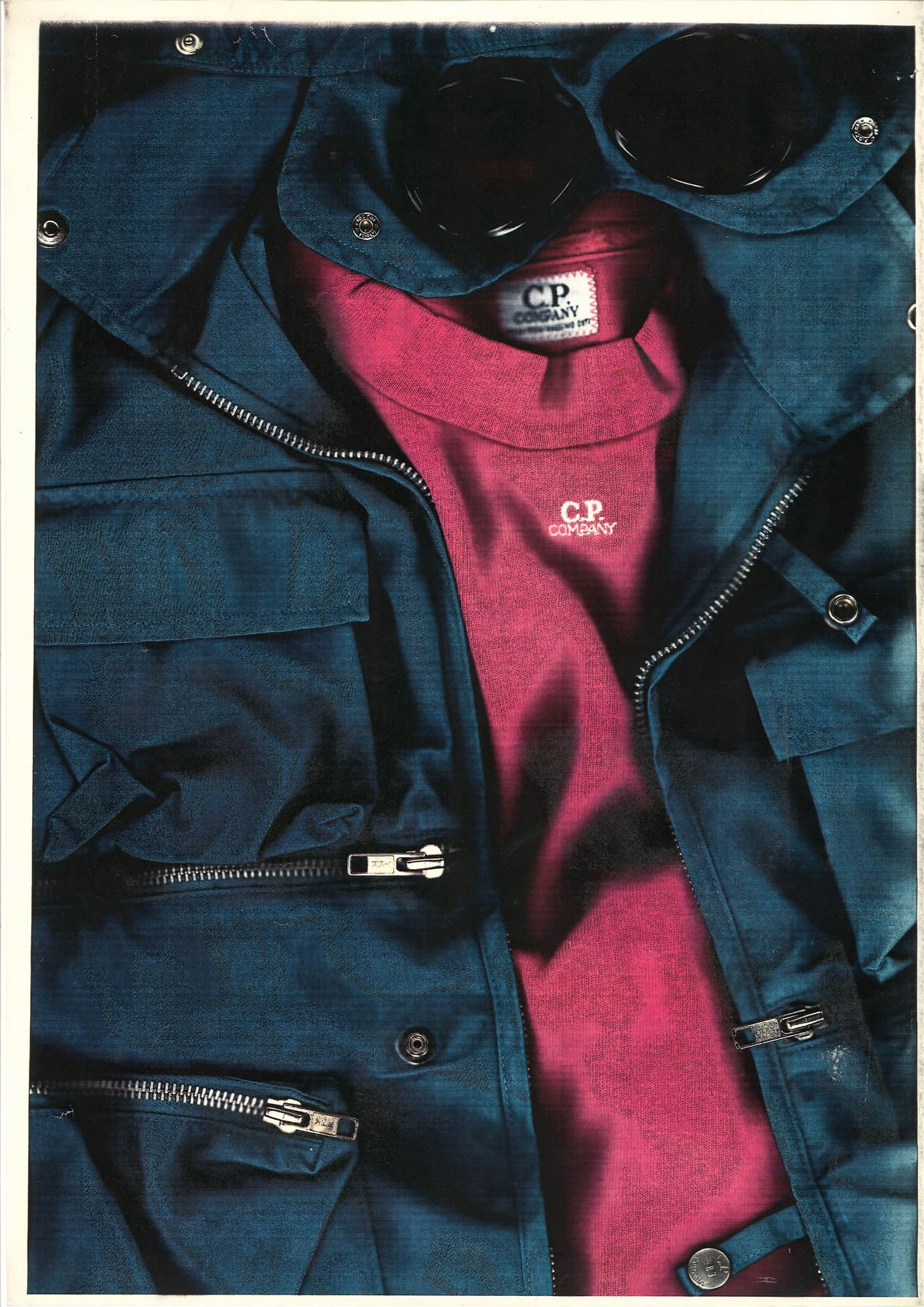 Jacket with glasses integrated into the hood and t-shirt. C.P. Company. Photocopy from M.O. Archive