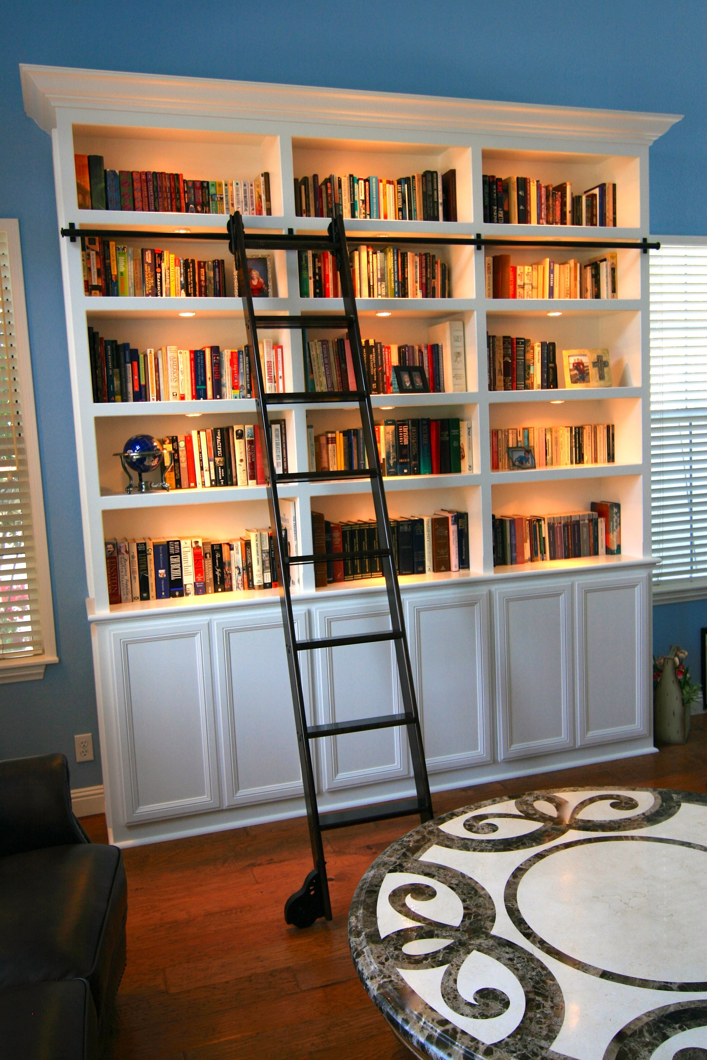 Bookcase with a rolling library ladder bookcase home