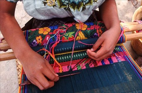Mayas in the Guatemalan highlands are still weaving beautiful textiles much the same way as their ancestors did 1,200 years ago. Today, women weave cotton and wool on a backstrap loom, which is looped around the weaver, who sits on the ground. Many weavers now use chemical dyes to color the fibers, though some still use natural dyes derived from moss, bark, and other plants.