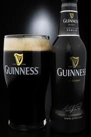 A bottle of guiness makes my honey smile