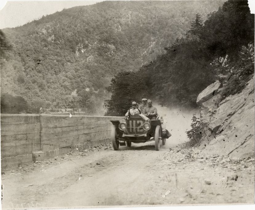 Motorists in Stoddard-Dayton automobile traveling on mountain road at Delaware Water Gap, 1908 Glidden Tour