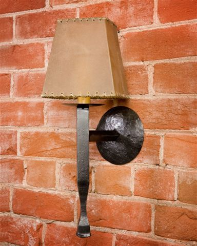 """This simple yet elegant wall sconce is hand forged and hand burnished from top to bottom. 4""""L x 14""""H x 5""""D Shades available as additional purchase."""