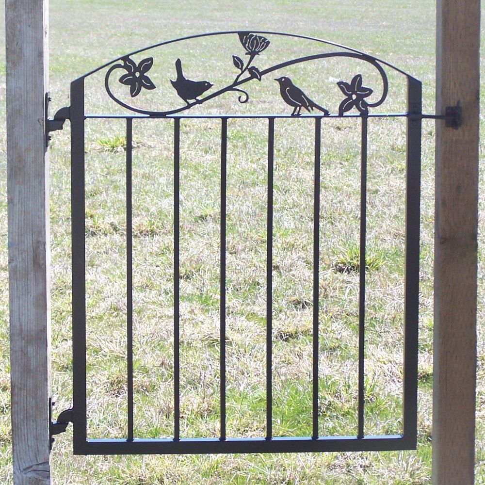metal art iron garden gate with birds and by