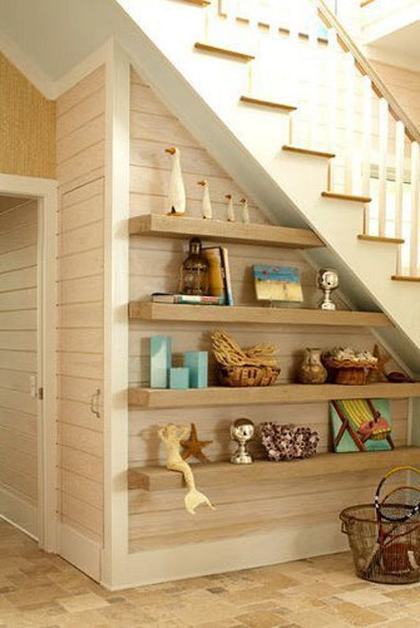 under stair shelves. I love those under stair bathrooms, so if I end up  doing that this is another neat way of utilizing the space underneath with  shelves.