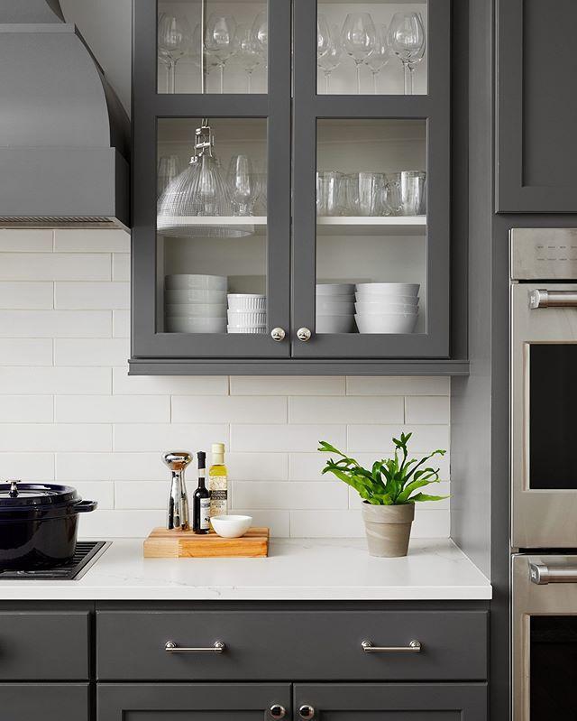 Dark gray kitchen cabinets, white subway tile backsplash, quartz countertops, dark kitchen - Centered by Design #darkkitchencabinets