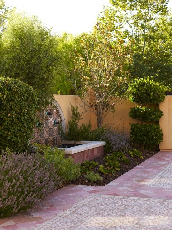 Courtyard with wall fountain for front yard. Mediterranean Landscape