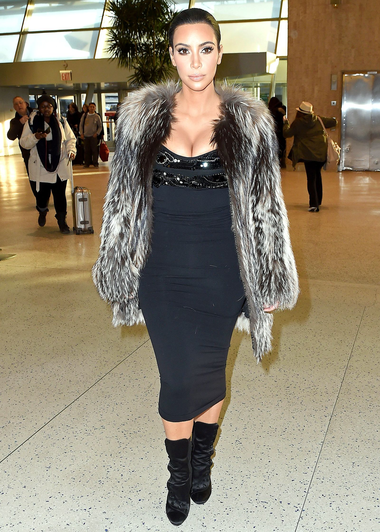 Kim Kardashian challenged the fashion norm by showing lots of cleavage in a black dress with