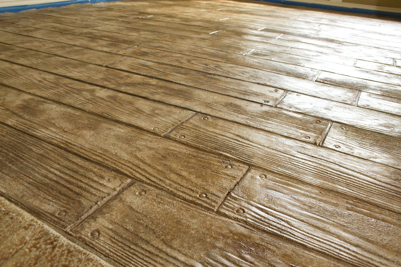 Looks Like A Hardwood Floor But Is Really Stamped Concrete