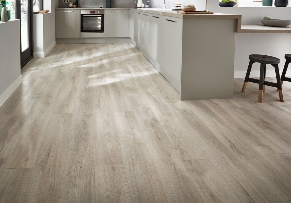 A White Washed Oak Laminate Floor And Stone Effect Worktop Will Introduce Organic Elements To Your Kitchen To Kitchen Flooring Flooring Oak Laminate Flooring