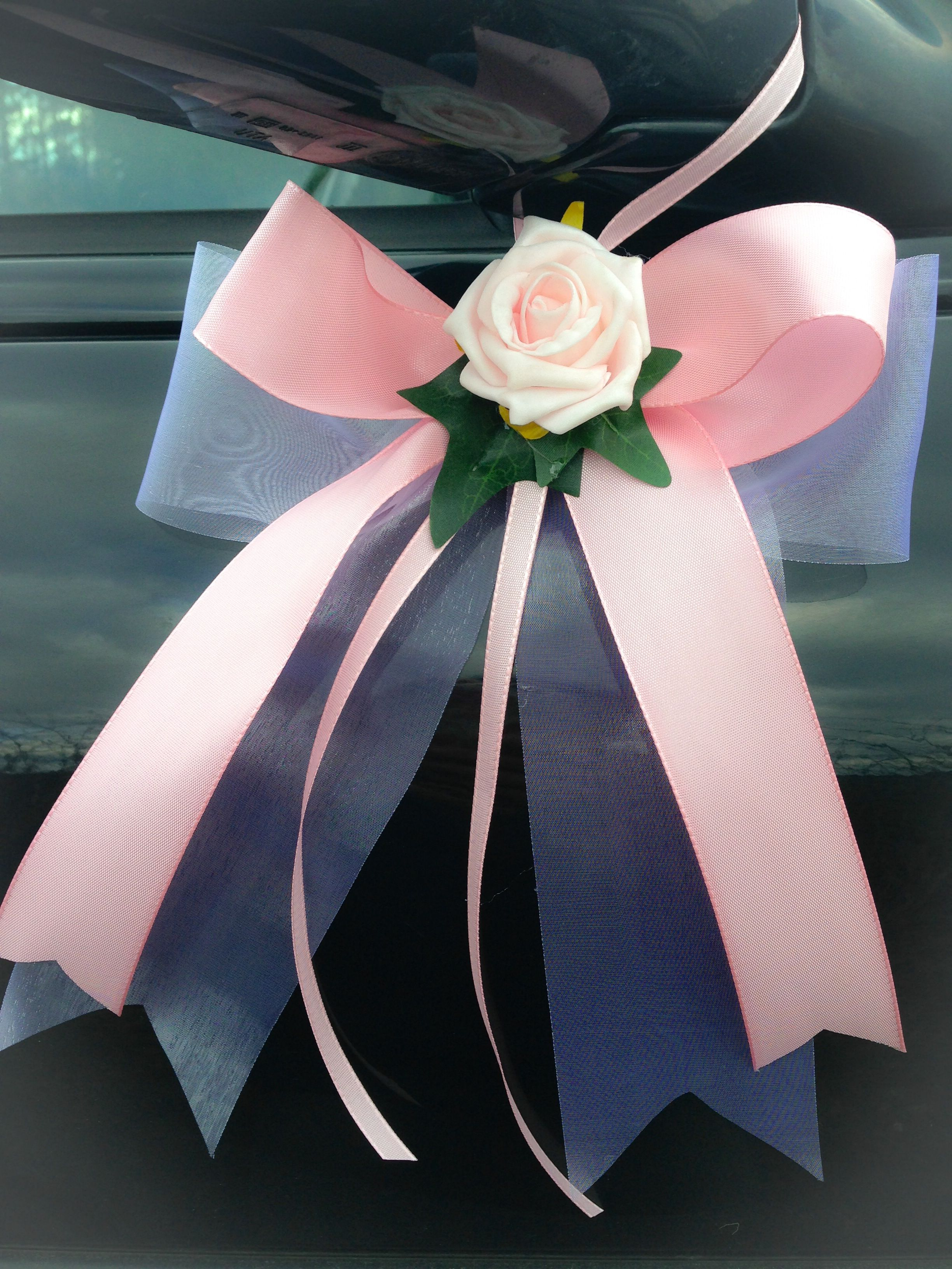 Wedding car decoration ideas  Light pink wedding car garland inclusive  doves and  bows weather