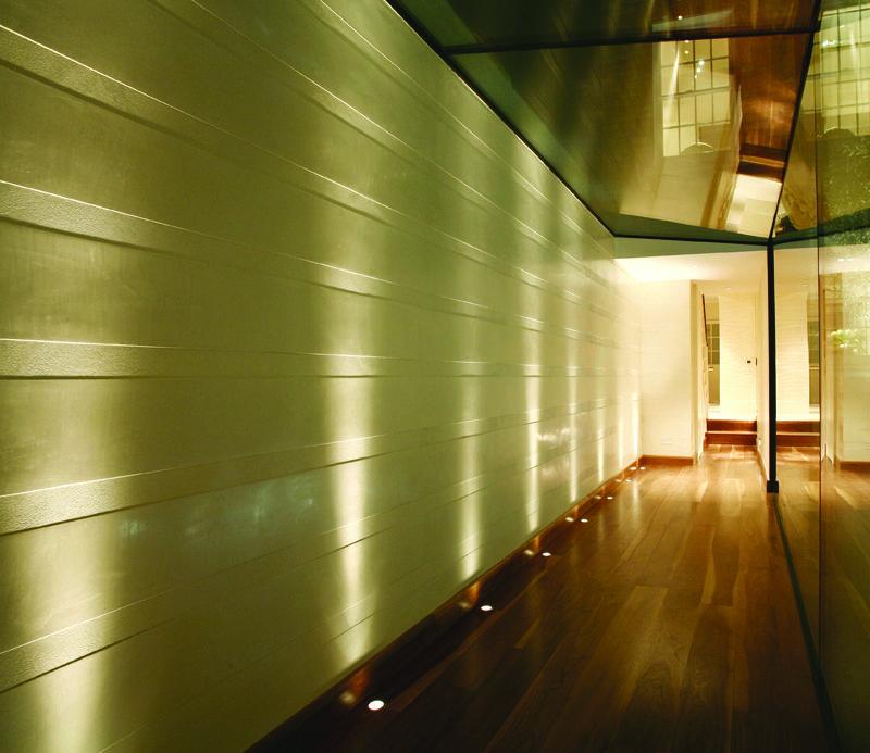 Lighting Basement Washroom Stairs: Uplit Textured Wall By John Cullen Lighting.