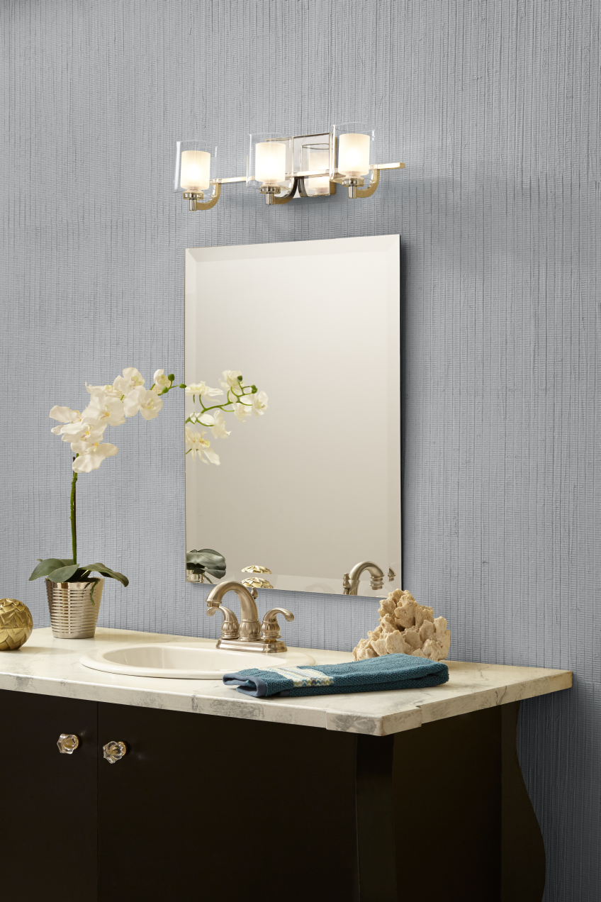 Quoizel Kolt: This modern, posh bath light collection features a simple design with a sleek polished chrome finish. The opal etched glass shades are encased with clear glass for a sophisticated and stunning look. Brushed nickel and polished chrome finishes are available. You can get sizes from 2 to 5 light and select fixtures use LED light.