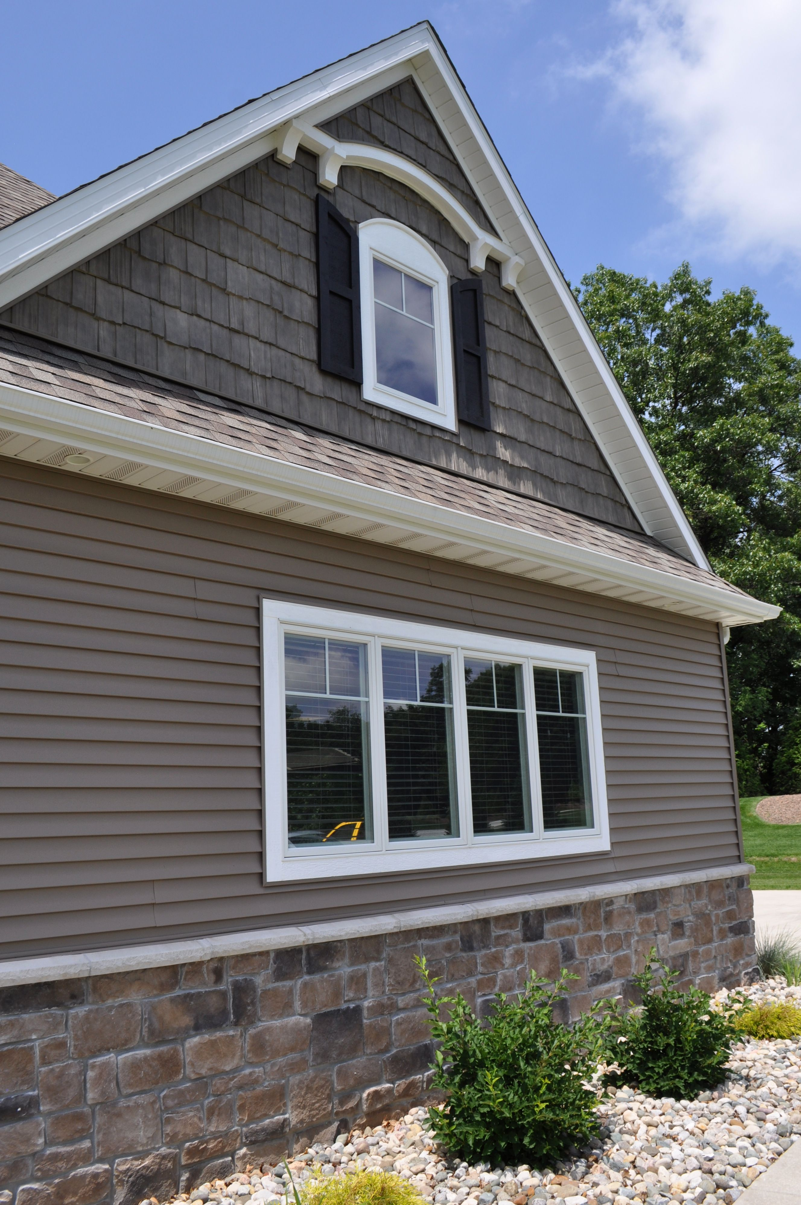 beautiful dark siding home with stoned wainscot price cut cobble