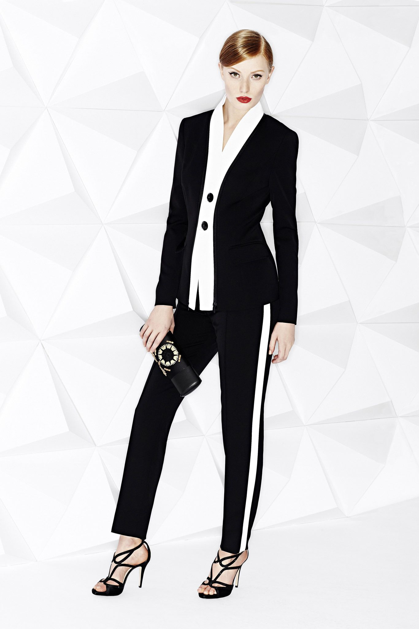 There is nothing androgynous about this Escada Resort 2015 suit. More on the suit trend and other top trends here: http://balharbourshops.com/fashion/trend-report/resort-2015/this-suits-you