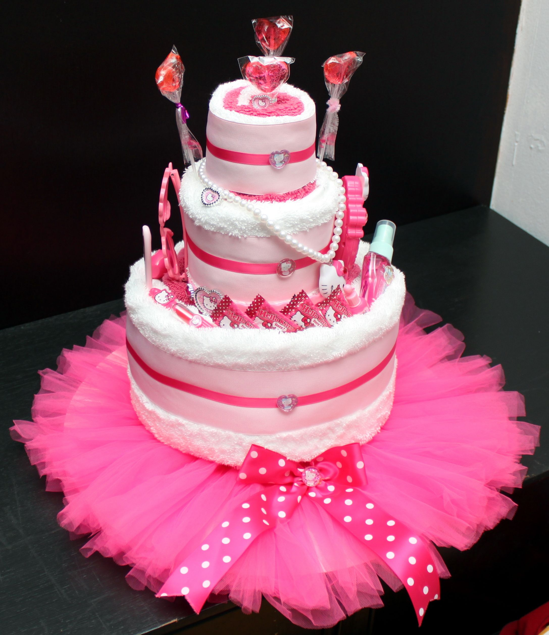 3 tier towel cake set on tutu cake board for 1st birthday