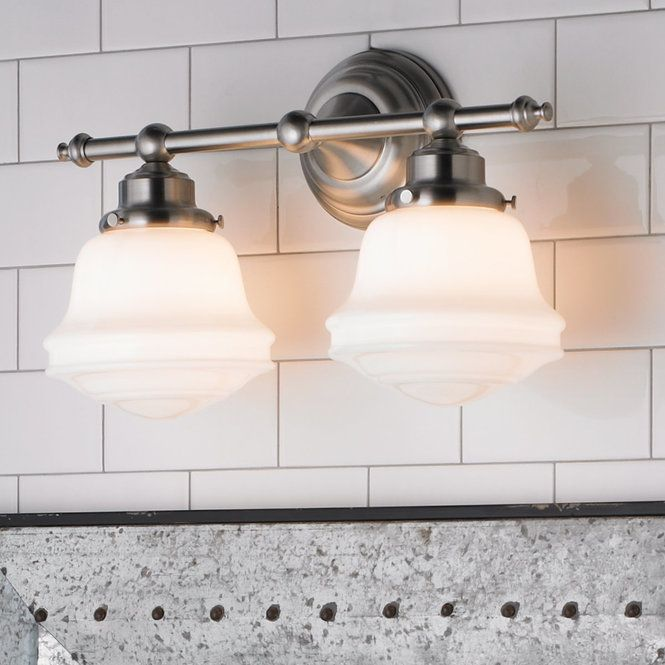 This two-light bathroom fixture features a milk glass look that ...