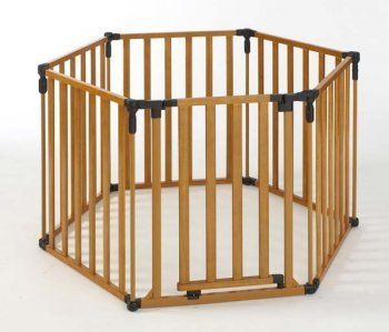 Set up a wooden playpen around your Christmas tree to keep ...