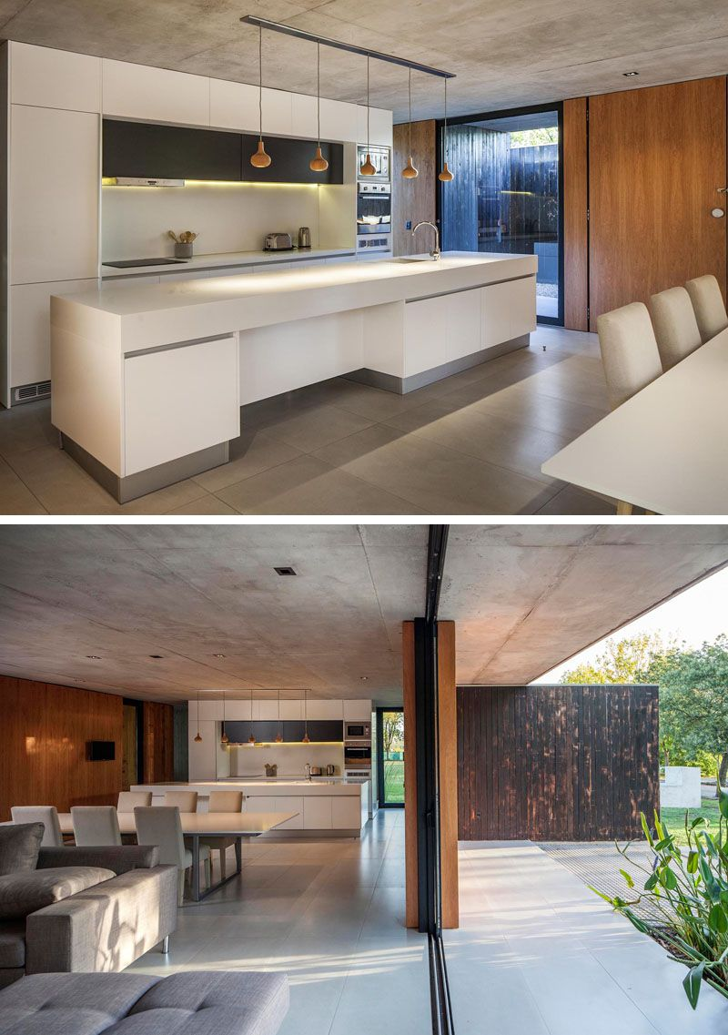 The bottom floor of this concrete and wood house is almost completely open to outside also best architecture images in modern design rh pinterest