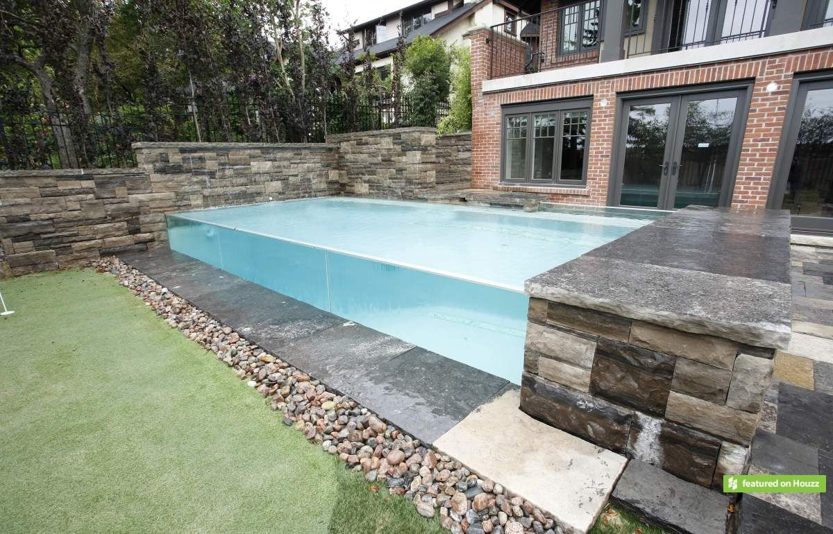 Elevated Pool a tall cedar fence offers privacy for this small toronto yard