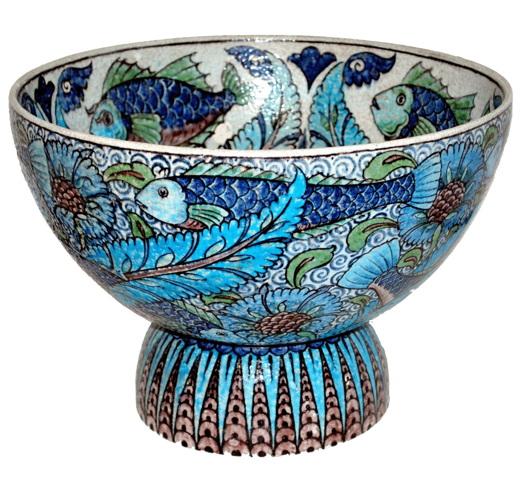 """Fish Punch Bowl designed by William De Morgan and decorated by Fred Passenger, 1890-1904. Inspired by the richly decorated ceramics from Isnik (Turkey) De Morgan's """"Persian"""" ware encompassed vibrant blue and green glazes and images. Galleons and fish designs are much prized by collectors today. ~via the De Morgan Centre, FB"""