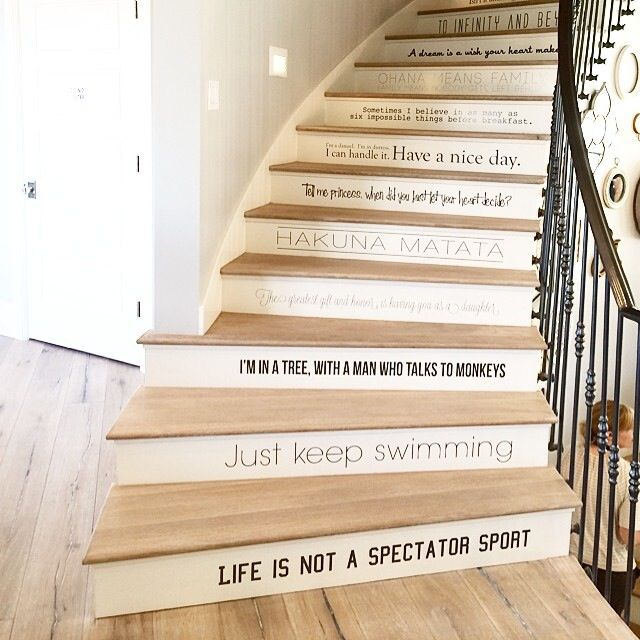 21 Staircase Decorating Ideas: Sweeping Staircase With Disney Quotes.