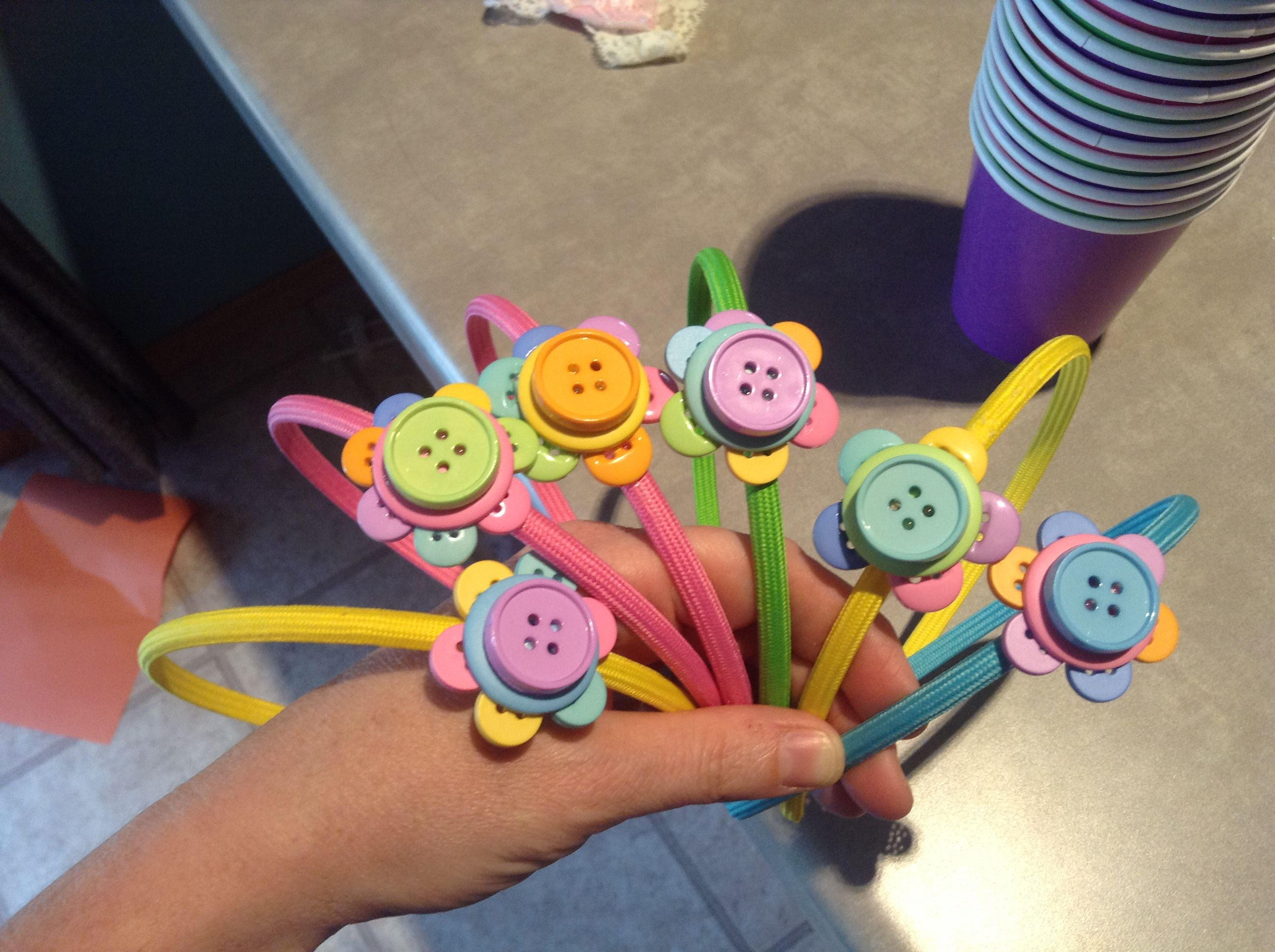 My version of Lalaloopsy button headbands for the girls coming to the party :)