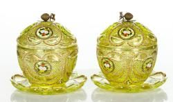 "Pair of 19th century Bohemian covered candy dishes, cut and enameled vaseline glass, with under plates, with gilt detailing, made for the Islamic, Turkish, and Persian markets, dishes 8"" h x 7"" dia, under plates 8 1/2"" dia."