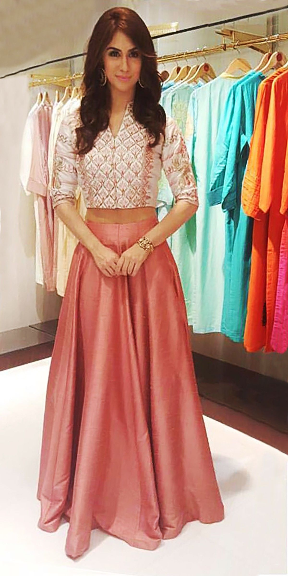 Featuring a crop top and skirt in shades of blush to wear for Wedding dress skirt and top
