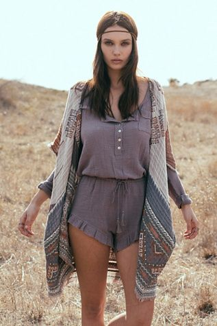 Gauze Romper | Free People Button-down long-sleeve romper, made from our sheer and gauzy Endless Summer fabric, featuring a breast pocket, tassel drawstring waist, and sweet ruffle hem.