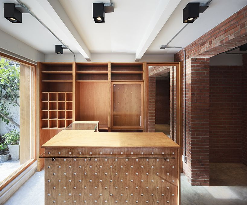 Located In Downtown Bangkok Keaton By Phtaa Living Design Is A Modern Reinterpretation Of A Vintage Tailor Sh Tailor Shop Shop Interior Design Living Design