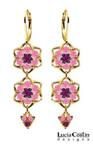 14K Yellow Gold Plated over .925 Sterling Silver Flower Shaped Dangle Earrings by Lucia Costin with Violet, Pink Swarovski Crystal Flowers, 3 Stones Suspended and Twisted Lines; Handmade in USA Lucia Costin. $84.00. Mesmerizing enough to wear on special occasions, but durable enough to be worn daily. Embellished with purple and rose Swarovski crystals. Unique jewelry handmade in USA. Floral design accompanied by cute details. Lucia Costin flower shaped drop earrings