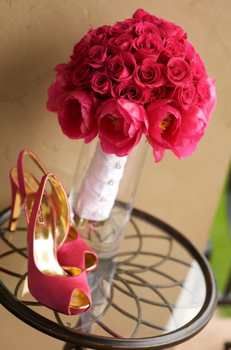 Displayed On Table Is An Elegant Fuchsia Fl Arrangement In Vase Beside Fabulous Heels That Match