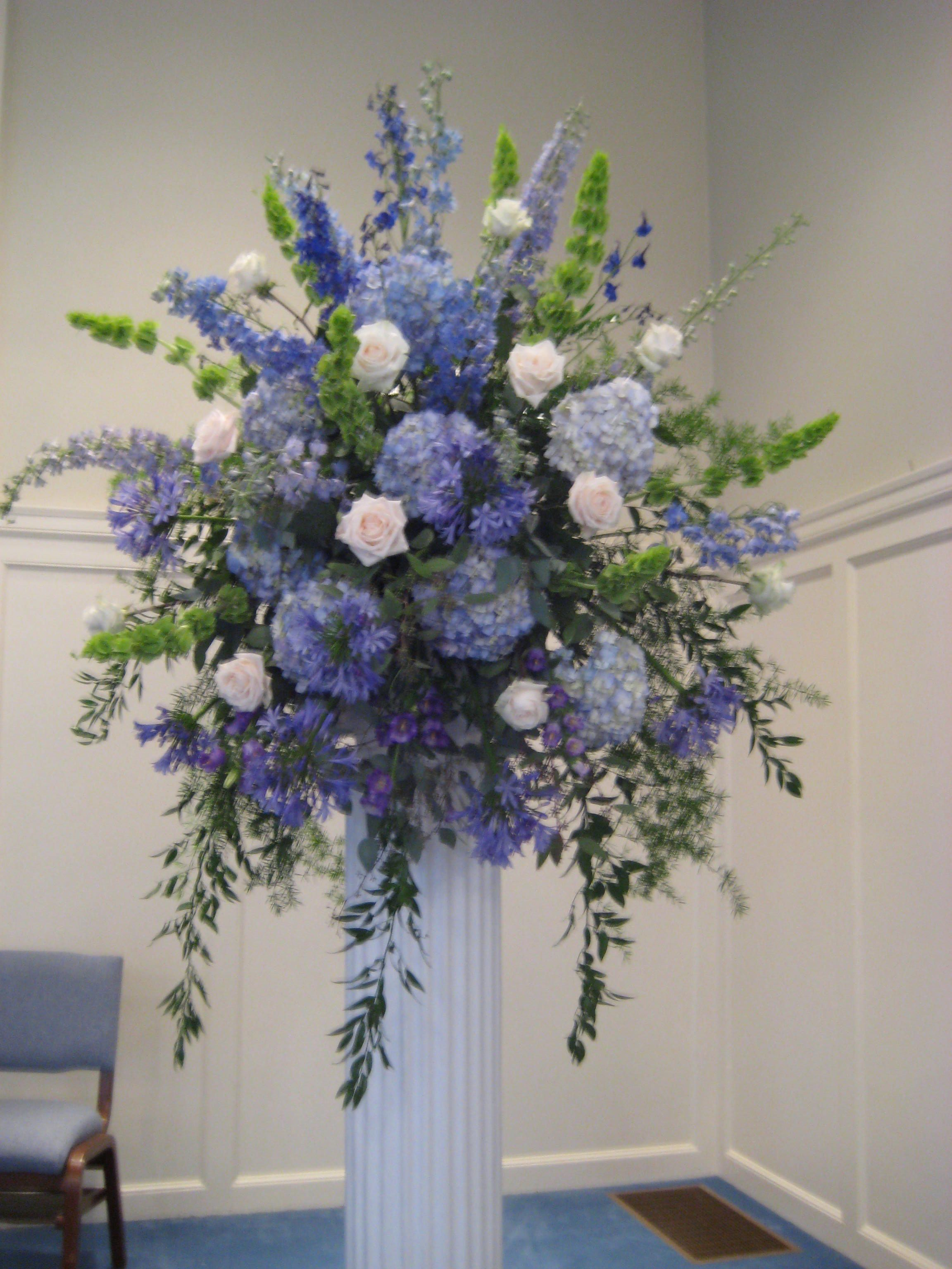 Hydrangea delphinium bells of ireland agapanthus blue for Floral arrangements for wedding reception centerpieces
