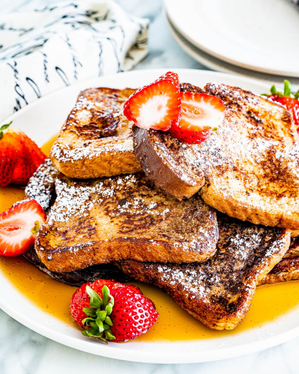 French Toast Featuring Thick Slices Of Bread Soaked In Egg Beaten With Milk And Cinnamon Fried In Butter And Sweet Breakfast Toast French Bread French Toast