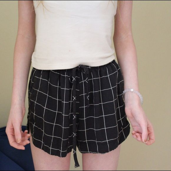 brandy Melville eve shorts Loose fitting black and white grid shorts from brandy Melville...really great condition worn about once for a short amount of time...also fits about everyone because of the stretchy waist and the drawstring ties. Brandy Melville Shorts
