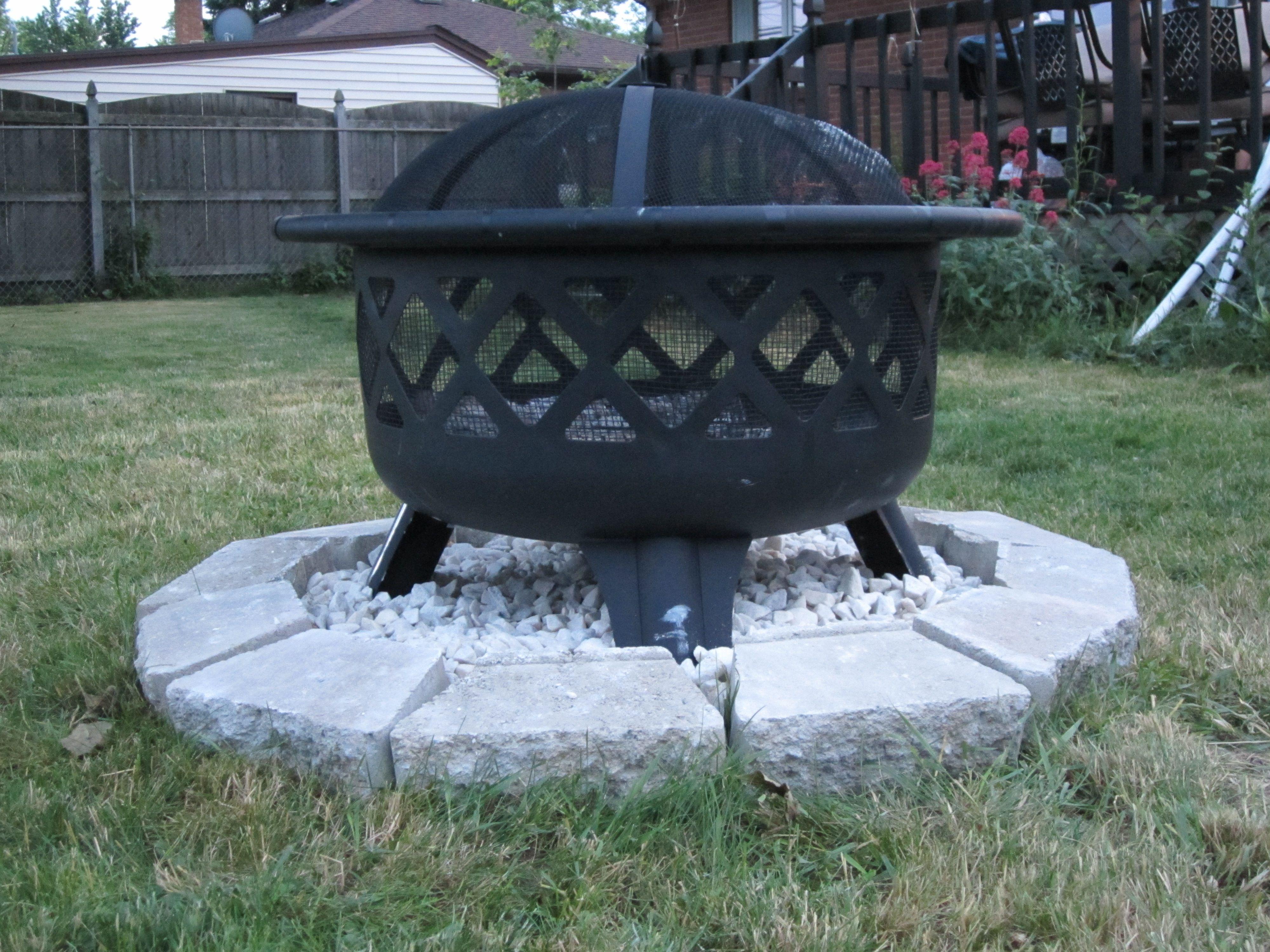 DIY little rock pit for your fire pit. Put a plastic