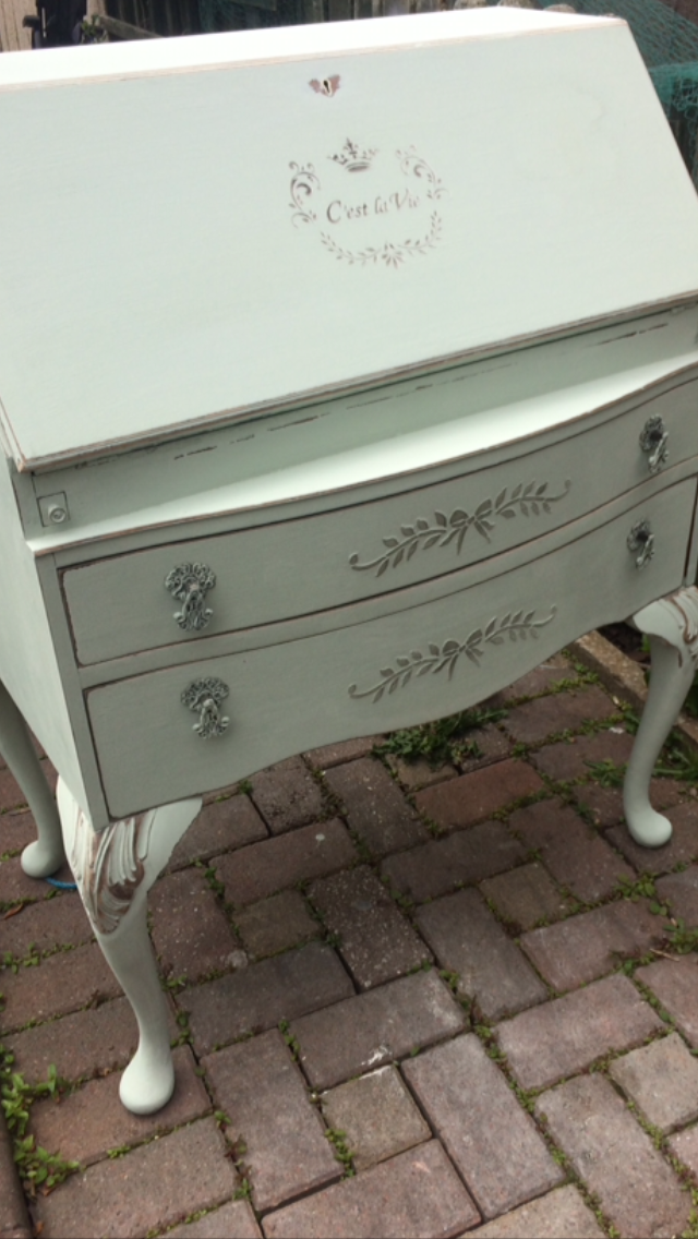 Painted in laurel green chalk paint distressed and raise stencilled