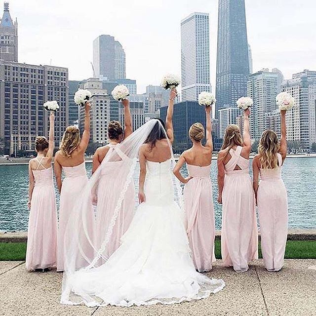 Looking oh-so fabulous is this @ritavinieris bride and her pretty in pink squad 💕! Photo: @marquetteavenueevents | Dress Store: @bellabiancabridalcouture #RitaVinieris