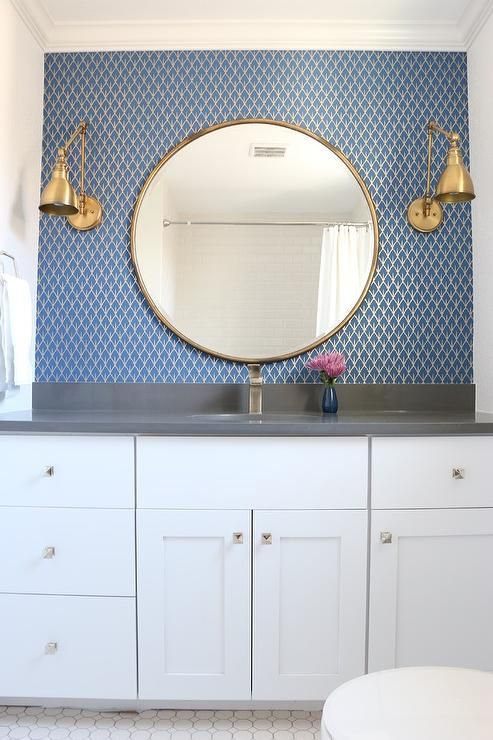 Blue And Gold Bathroom Boasts A Wall Clad In Gold And Blue