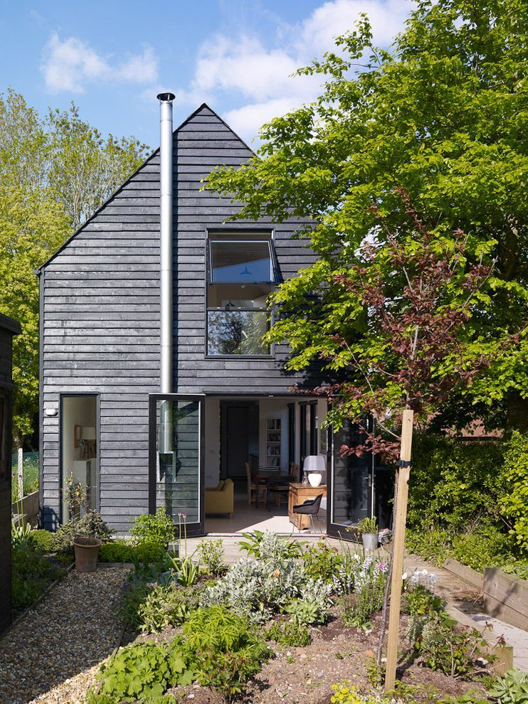 Black Siding Exterior Transitional With Timber Frame