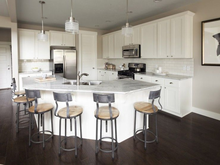 Stunning kitchen with contemporary glass pendants over angled ...