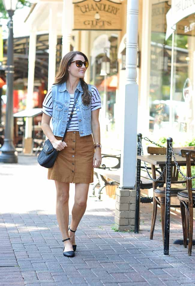 76e39dc76 Cute and casual outfit idea to transition into fall via Peaches In a Pod  blog. Suede skirt outfit idea, suede skirt, striped top, black flats, denim  vest.