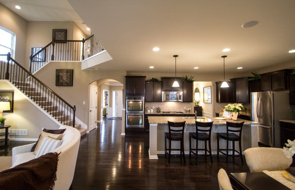 Love Everything About This Open Floor Plan Dark Floors Stairs